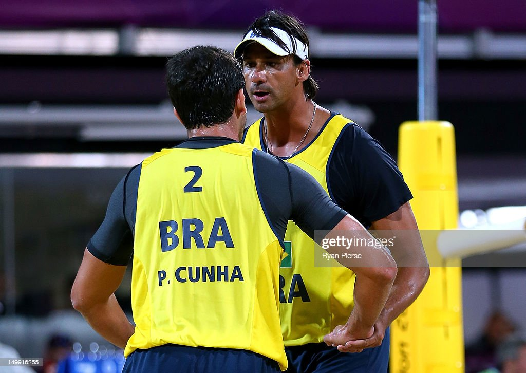 Ricardo Santos and Pedro Cunha of Brazil react against Jonas Reckermann and Julius Brink of Germany during the Men's Beach Volleyball quarterfinal match between Germany and Brazil on Day 10 of the London 2012 Olympic Games at Horse Guards Parade August 6, 2012 in London, England.