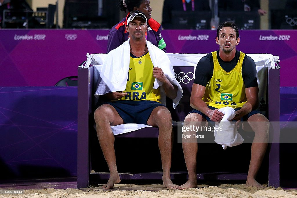 Ricardo Santos and Pedro Cunha of Brazil sit dejected after the lost against Jonas Reckermann and Julius Brink of Germany during the Men's Beach Volleyball quarterfinal match between Germany and Brazil on Day 10 of the London 2012 Olympic Games at Horse Guards Parade August 6, 2012 in London, England.