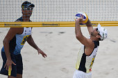 Ricardo Santos in action against Marcio Araujo during a men's quarterfinals match on Day 2 of the Banco do Brasil Beach Volleyball Open at Icarai...