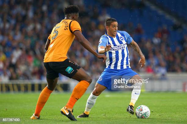 Ricardo Santos of Barnet puts pressure on Anthony Knockaert of Brighton and Hove Albion during the Carabao Cup Second Round match between Brighton...