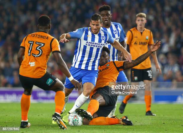 Ricardo Santos of Barnet tackles Tomer Hemed of Brighton and Hove Albion during the Carabao Cup Second Round match between Brighton Hove Albion and...