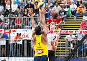 Ricardo Santos of Brazil and Christiaan Varenhorst of Netherlands compete in the gold medal at Jose Correa Gymnasium during day six of the FIVB Sao...