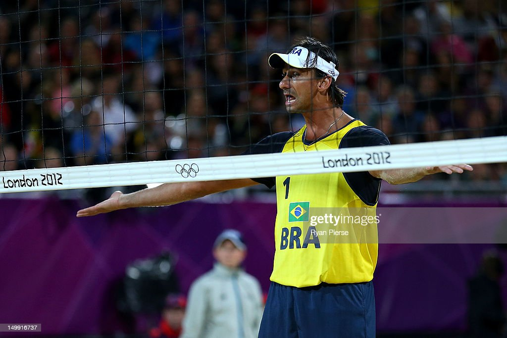 Ricardo Santos (playing partner of Pedro Cunha) of Brazil reacts against Jonas Reckermann and Julius Brink of Germany during the Men's Beach Volleyball quarterfinal match between Germany and Brazil on Day 10 of the London 2012 Olympic Games at Horse Guards Parade August 6, 2012 in London, England.