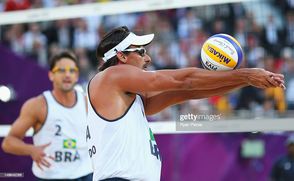 Ricardo Santos of Brazil returns the ball during the Men's Beach Volleyball preliminary match between the Brazil and Canada on Day 5 of the London 2012 Olympic Games at Horse Guards Parade on August 1, 2012 in London, England.