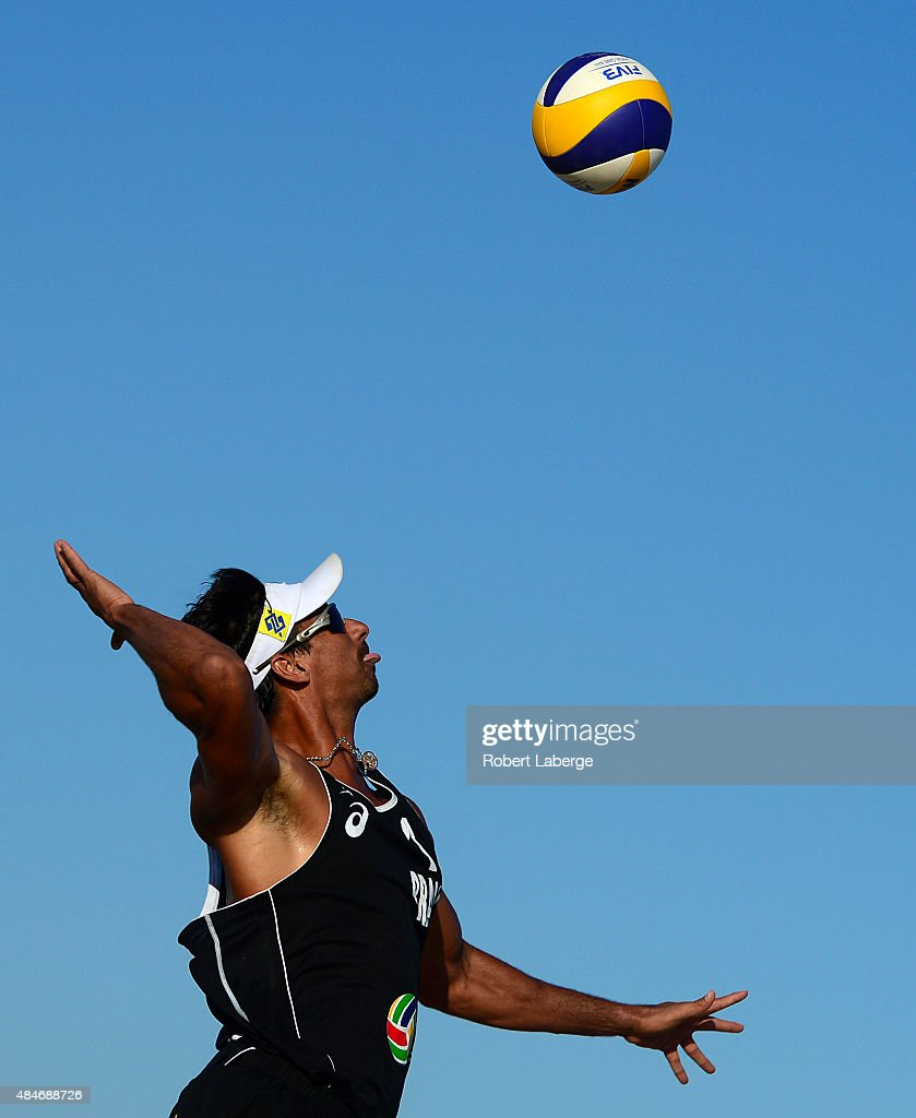Ricardo Santos of Brazil serves during the 2015 ASICS World Series of Beach Volleyball at the TrueCar Course at Alamitos Beach on August 20, 2015 in Long Beach, California.
