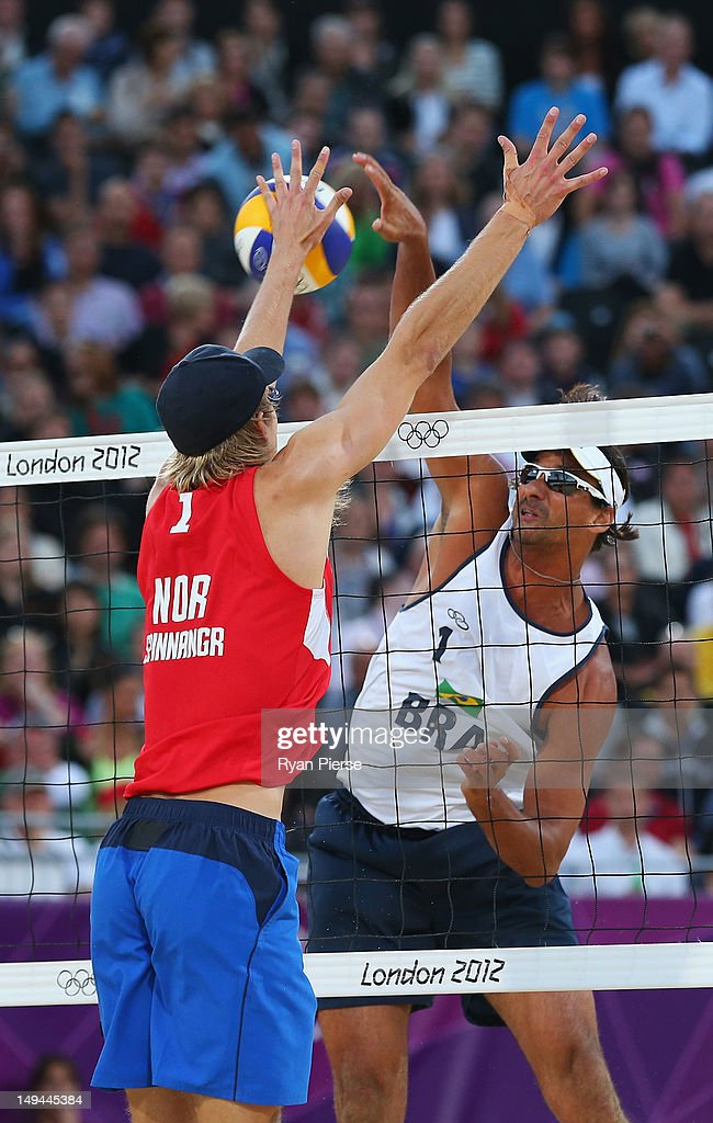 Ricardo Santos of Brazil spikes against Martin Spinnangr of Norway during the Men's Beach Volleyball Preliminary Round between on Day 1 of the London 2012 Olympic Games at Horse Guards Parade on July 28, 2012 in London, England.