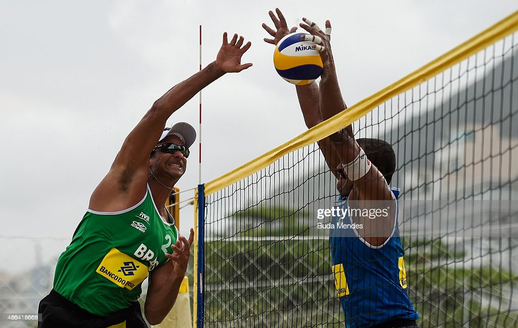 Ricardo Santos of Brazil spikes the ball as Lipe Rodrigues of Brazil attempts a block during the FIVB Beach Volleyball World Tour Rio Open at Copacabana beach on September 3, 2015 in Rio de Janeiro, Brazil. This event serves as a test for Rio 2016.