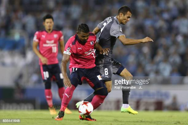 Ricardo Santos of Cerezo Osaka and Fozil Musaev of Jubilo Iwata compete for the ball during the JLeague J1 match between Jubilo Iwata and Cerezo...