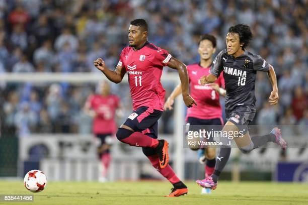 Ricardo Santos of Cerezo Osaka controls the ball under pressure of Shunsuke Nakamura of Jubilo Iwata during the JLeague J1 match between Jubilo Iwata...