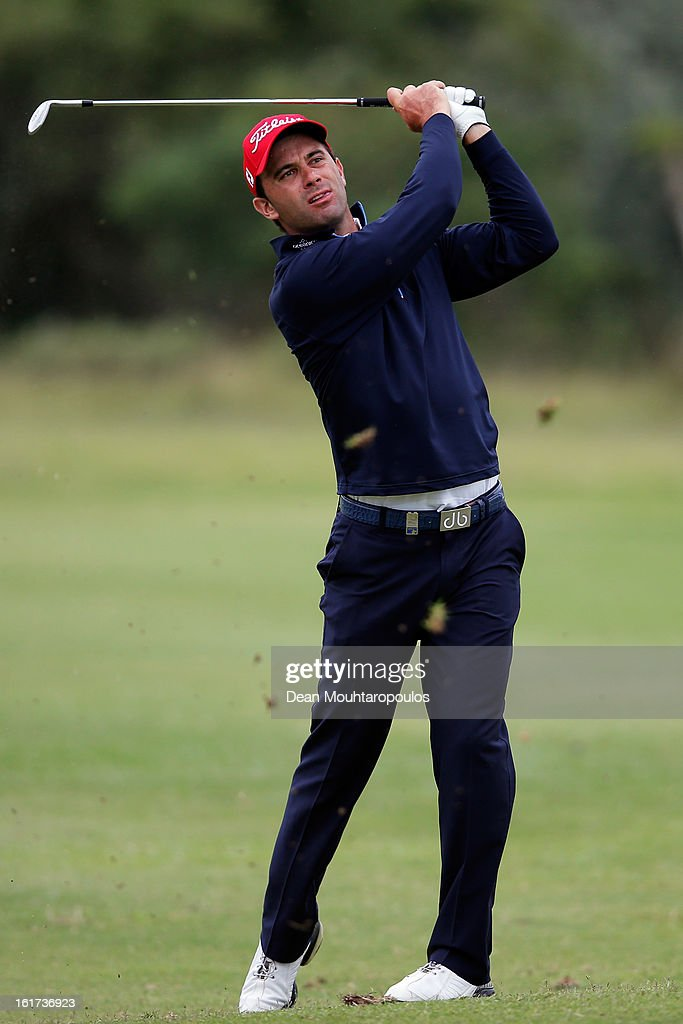 <a gi-track='captionPersonalityLinkClicked' href=/galleries/search?phrase=Ricardo+Santos+-+Golfer&family=editorial&specificpeople=14996103 ng-click='$event.stopPropagation()'>Ricardo Santos</a> of Portugal hits his second shot on the 13th hole during Day Two of the Africa Open at East London Golf Club on February 15, 2013 in East London, South Africa.