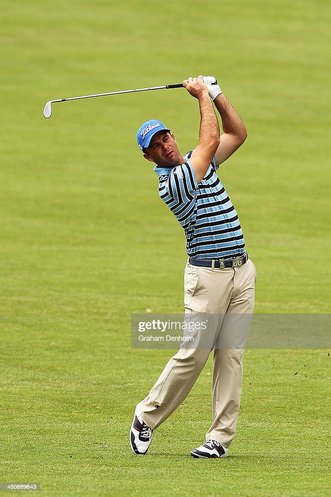Ricardo Santos of Portugal plays an approach shot during day one of the World Cup of Golf at Royal Melbourne Golf Course on November 21, 2013 in Melbourne, Australia.