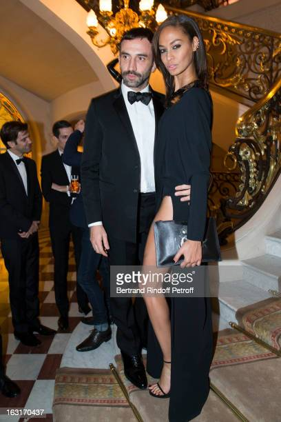 Ricardo Tisci and Joan Smalls attend the 'CR Fashion Book Issue 2' Carine Roitfeld Cocktail as part of Paris Fashion Week at Hotel ShangriLa on March...