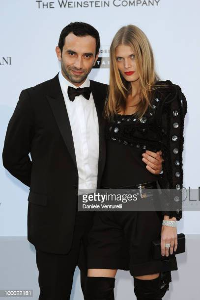 Ricardo Tisci and Malgosia Bela arrives at amfAR's Cinema Against AIDS 2010 benefit gala at the Hotel du Cap on May 20 2010 in Antibes France