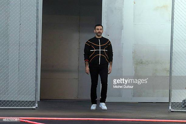 Ricardo Tisci walks the runway during the Givenchy Menswear Fall/Winter 20142015 show as part of Paris Fashion Week on January 17 2014 in Paris France