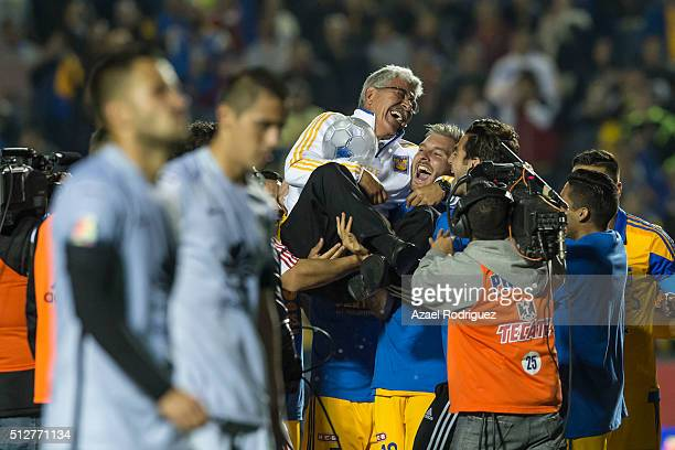 Ricardo Tuca Ferretti coach of Tigres celebrates with players his 400th victory at the end of a 8th round match between Tigres UANL and America as...