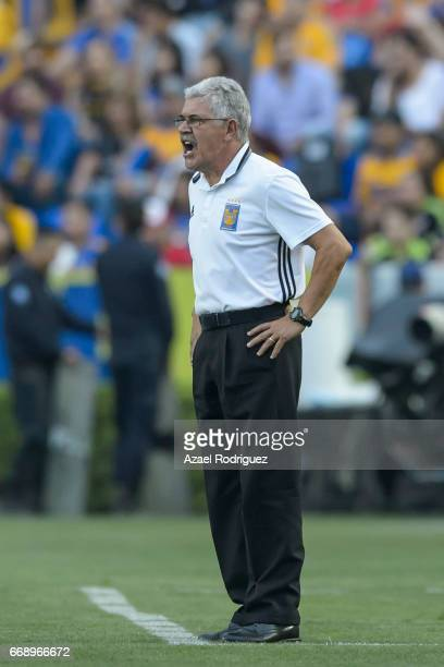 Ricardo 'Tuca' Ferretti coach of Tigres gives instructions during the 14th round match between Tigres UANL and Pumas UNAM as part of the Torneo...