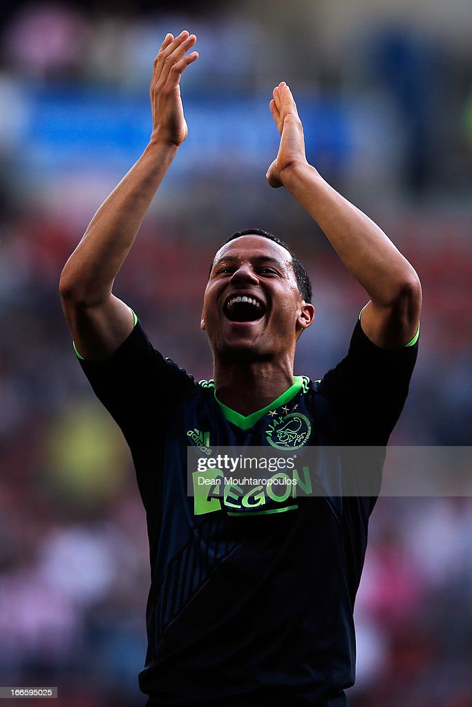 Ricardo Van Rhijn of Ajax celebrates after victory in the Eredivisie match between PSV Eindhoven and Ajax Amsterdam at Philips Stadion on April 14, 2013 in Eindhoven, Netherlands.