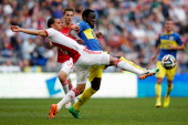 Ricardo Van Rhijn of Ajax tackles Elvis Manu of Cambuur during the Eredivisie match between Ajax Amsterdam and SC Cambuur Leeuwarden at Amsterdam...