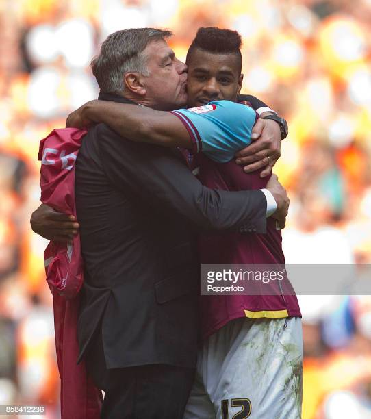 Ricardo Vaz Te of West Ham gets a kiss from manager Sam Allardyce after his team win the nPower Championship Playoff Final between West Ham United...