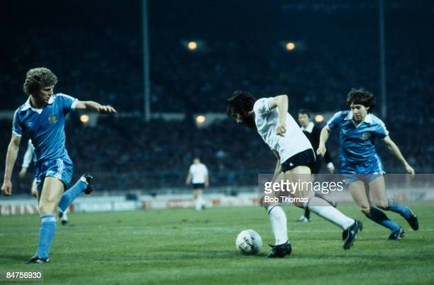 Ricardo Villa moves between Manchester City defenders Tommy Caton and Ray Ranson before scoring the winning goal for Tottenham Hotspur in the FA Cup...