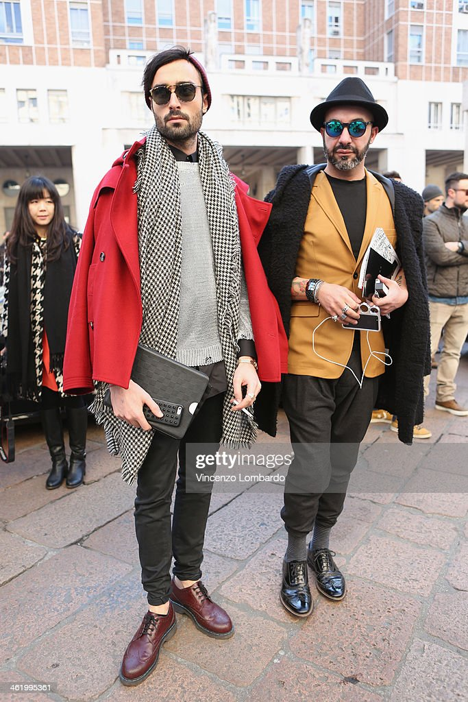 Riccardo Cavallin Sartori (L) and Marco Maria Conte Salata are seen during Milan Fashion Week Menswear Autumn/Winter 2014 on January 12, 2014 in Milan, Italy.