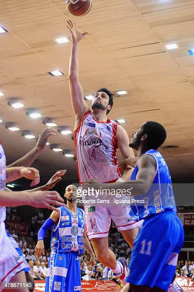 Riccardo Cervi of Grissin Bon competes with David and Jerome Dyson of Banco di Sardegna during the match of LegaBasket Serie A playoff Final Game 7...