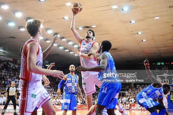 Riccardo Cervi of Grissin Bon competes with Jerome Dyson of Banco di Sardegna during the match of LegaBasket Serie A game 7 of playoff's final series...