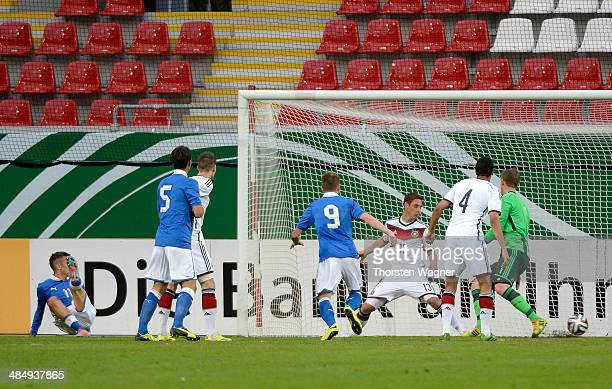 Riccardo Improta of Italy is scoring his teams opening goal during the U20 international friendly match between Germany and Italy at Sparda Bank...