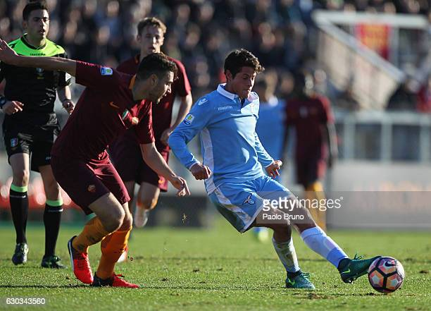 Riccardo Marchizza of AS Roma competes for the ball with Alessandro Rossi of SS Lazio during the Primavera Tim Cup juvenile match between AS Roma and...