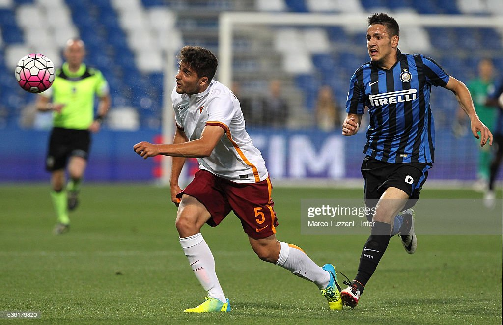 Riccardo Marchizza of AS Roma competes for the ball with Rey Manaj of FC Internazionale during the juvenile playoff match between FC Internazionale and AS Roma at Mapei Stadium - Citta' del Tricolore on March 31, 2016 in Reggio nell'Emilia, Italy.