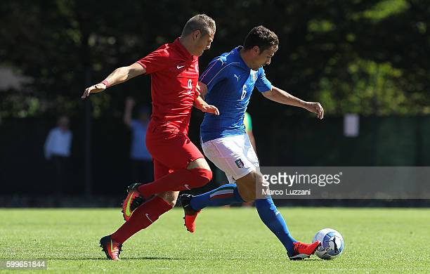 Riccardo Marchizza of Italy competes for the ball with Ilker Yuksel of Turkey during the international friendly match between Italy U19 and Turkey...