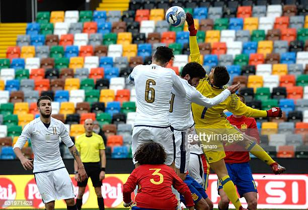 Riccardo Marchizza of Italy U19 competes with Alvaro Fernando Lorente goalkeeper of Spain U19 during the U19 International Friendly match between...