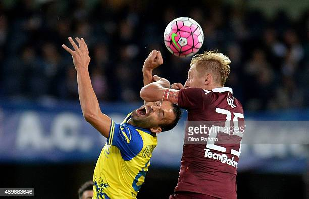 Riccardo Meggiorini of Chievo Verona battles for an aerial ball with Kamil Glik of Torino FC during the Serie A match between AC Chievo Verona and...