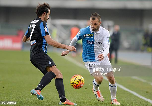 Riccardo Meggiorini of Chievo Verona competes with Cristian Raimondi of Atalanta BC during the Serie A match between AC Chievo Verona and Atalanta BC...