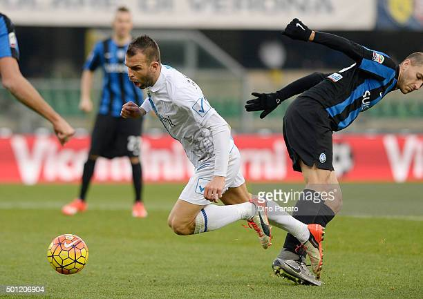Riccardo Meggiorini of Chievo Verona is tackled to Manuel Paletta of Atalanta BC during the Serie A match between AC Chievo Verona and Atalanta BC at...