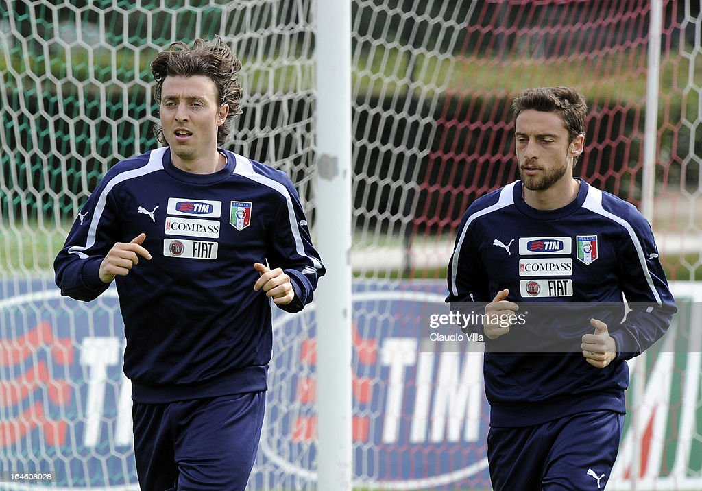<a gi-track='captionPersonalityLinkClicked' href=/galleries/search?phrase=Riccardo+Montolivo&family=editorial&specificpeople=605846 ng-click='$event.stopPropagation()'>Riccardo Montolivo</a> (L) and <a gi-track='captionPersonalityLinkClicked' href=/galleries/search?phrase=Claudio+Marchisio&family=editorial&specificpeople=4604252 ng-click='$event.stopPropagation()'>Claudio Marchisio</a> of Italy run during a training session at Coverciano on March 24, 2013 in Florence, Italy.