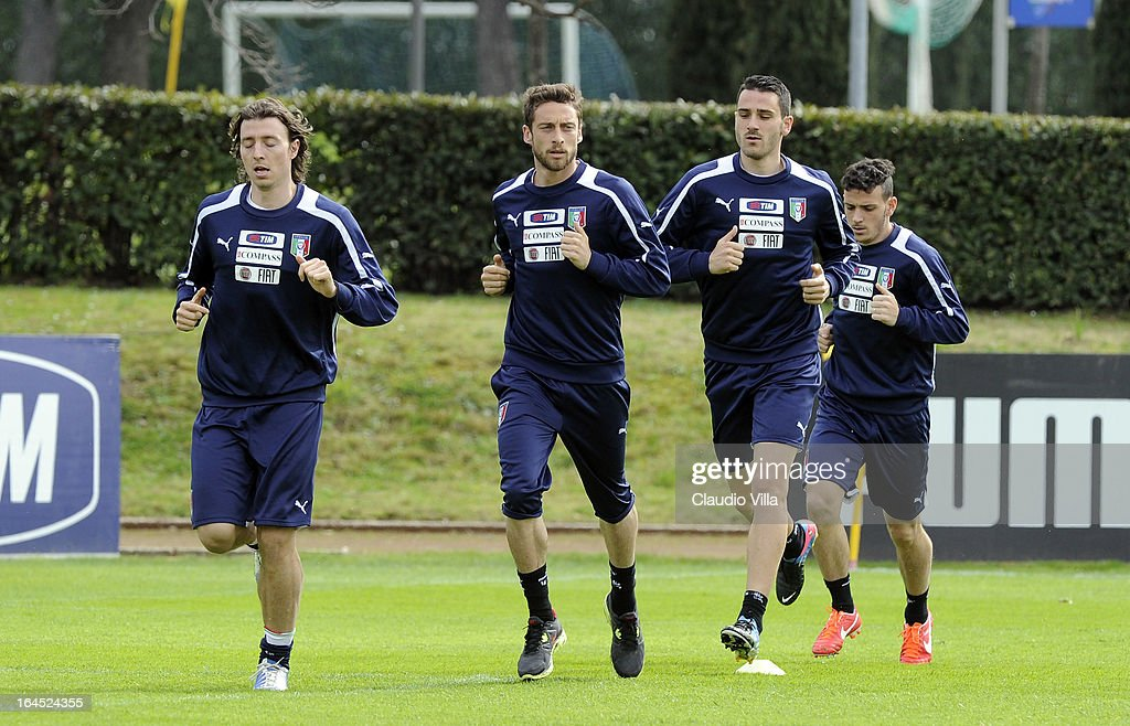 Riccardo Montolivo (L) and <a gi-track='captionPersonalityLinkClicked' href=/galleries/search?phrase=Claudio+Marchisio&family=editorial&specificpeople=4604252 ng-click='$event.stopPropagation()'>Claudio Marchisio</a> (2nd L) of Italy run with team-mates during a training session at Coverciano on March 24, 2013 in Florence, Italy.