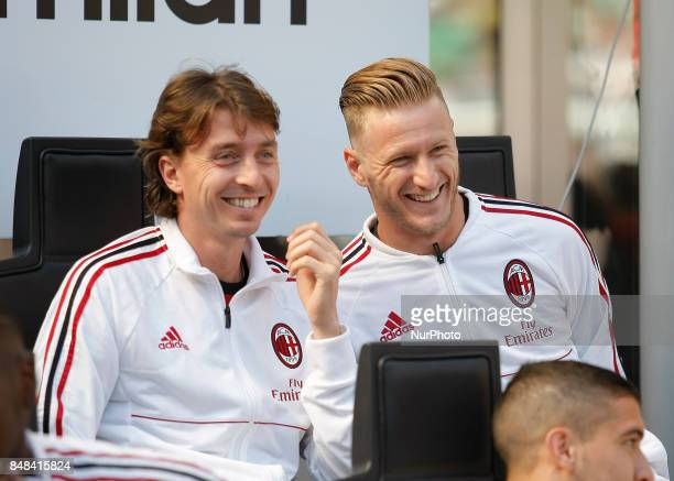 Riccardo Montolivo and Ignazio Abate during Serie A match between Milan v Udinese in Milan on September 17 2017