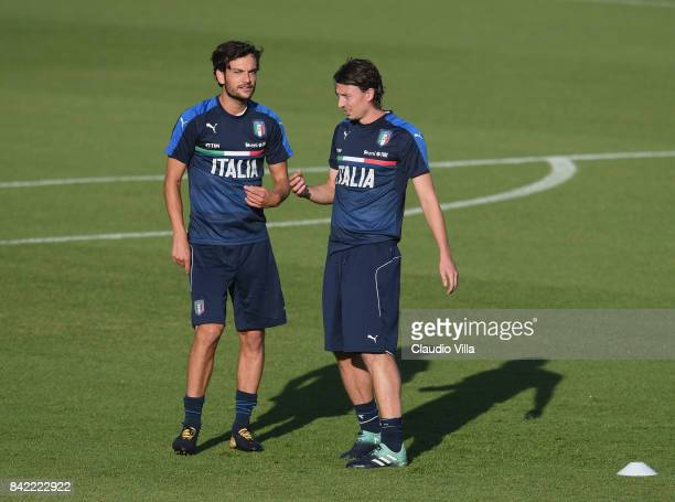 Riccardo Montolivo and Marco Parolo of Italy look on during the training session at Italy club's training ground at Coverciano on September 03 2017...