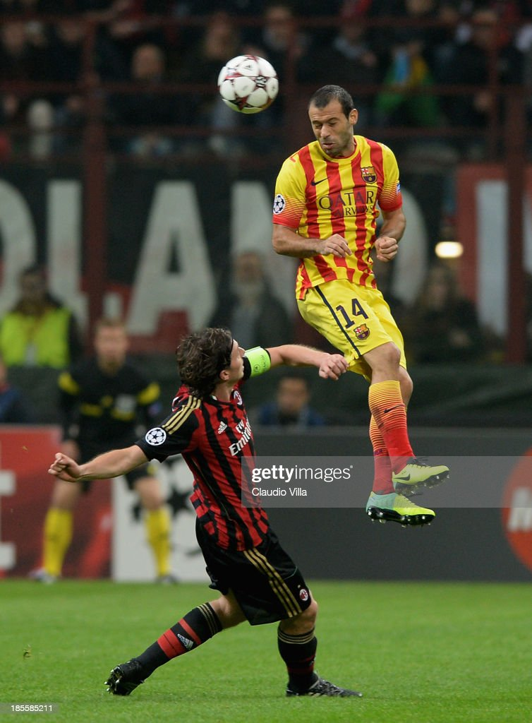 <a gi-track='captionPersonalityLinkClicked' href=/galleries/search?phrase=Riccardo+Montolivo&family=editorial&specificpeople=605846 ng-click='$event.stopPropagation()'>Riccardo Montolivo</a> of AC Milan and <a gi-track='captionPersonalityLinkClicked' href=/galleries/search?phrase=Javier+Mascherano&family=editorial&specificpeople=490876 ng-click='$event.stopPropagation()'>Javier Mascherano</a> of FC Barcelona (R) compete for the ball during the UEFA Champions League Group H match between AC Milan and Barcelona at Stadio Giuseppe Meazza on October 22, 2013 in Milan, Italy.