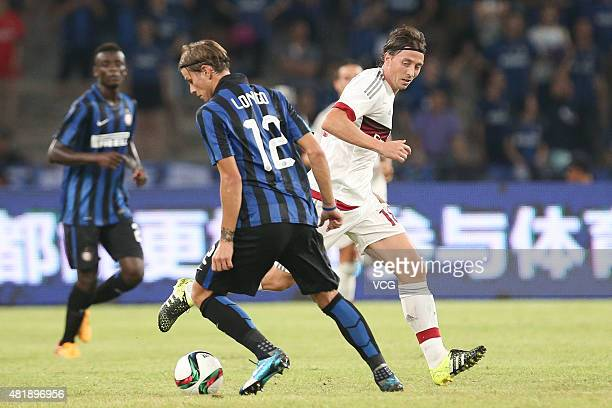 Riccardo Montolivo of AC Milan and Samuele Longo of Inter Milan compete for the ball during the International Champions Cup match between AC Milan...