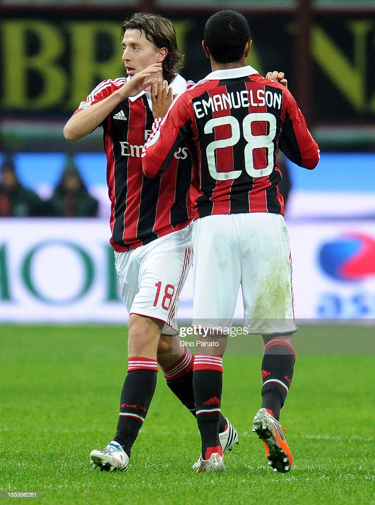 <a gi-track='captionPersonalityLinkClicked' href=/galleries/search?phrase=Riccardo+Montolivo&family=editorial&specificpeople=605846 ng-click='$event.stopPropagation()'>Riccardo Montolivo</a> of AC Milan celebrates after scoring is second team's goal with team mate <a gi-track='captionPersonalityLinkClicked' href=/galleries/search?phrase=Urby+Emanuelson&family=editorial&specificpeople=594399 ng-click='$event.stopPropagation()'>Urby Emanuelson</a> during the Serie A match between AC Milan and AC Chievo Verona at San Siro Stadium on November 3, 2012 in Milan, Italy.