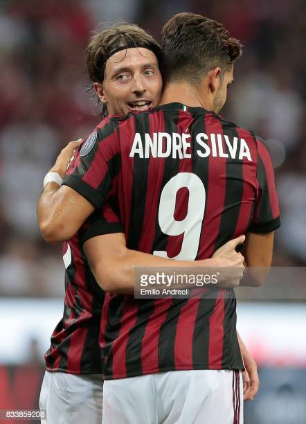Riccardo Montolivo of AC Milan celebrates his goal with his teammate Andre Silva during the UEFA Europa League Qualifying PlayOffs round first leg...