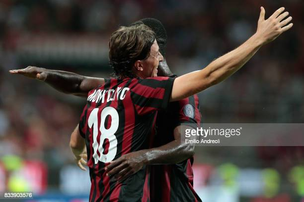 Riccardo Montolivo of AC Milan celebrates his goal with his teammate Cristian Zapata during the UEFA Europa League Qualifying PlayOffs round first...