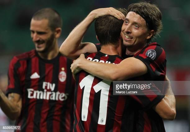 Riccardo Montolivo of AC Milan celebrates his second goal with his teammate Fabio Borini during the UEFA Europa League Qualifying PlayOffs round...