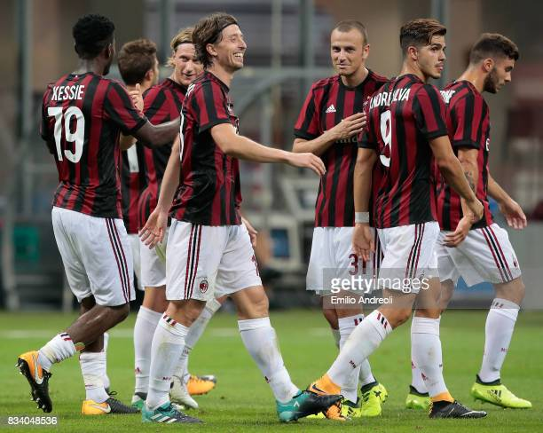 Riccardo Montolivo of AC Milan celebrates his second goal with his teammates during the UEFA Europa League Qualifying PlayOffs round first leg match...