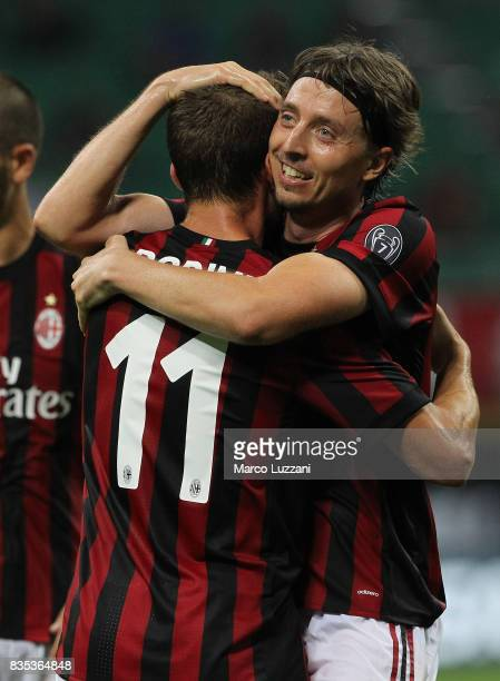 Riccardo Montolivo of AC Milan celebrates his second goal with his teammate Fabio Borini during the UEFA Europa League Qualifying PlayOffs round...