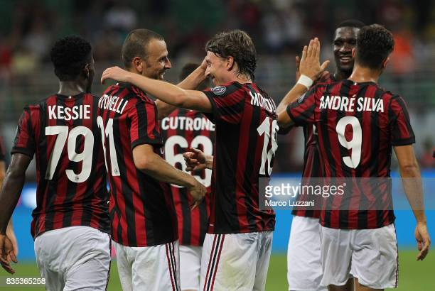 Riccardo Montolivo of AC Milan celebrates his second goal with his teammate Luca Antonelli during the UEFA Europa League Qualifying PlayOffs round...