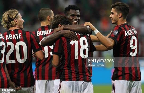 Riccardo Montolivo of AC Milan celebrates his second goal with his teammate Franck Kessie during the UEFA Europa League Qualifying PlayOffs round...