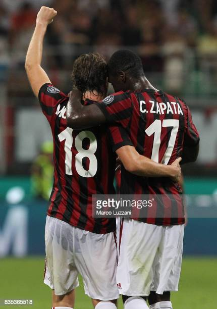 Riccardo Montolivo of AC Milan celebrates his second goal with his teammate Cristian Zapata during the UEFA Europa League Qualifying PlayOffs round...